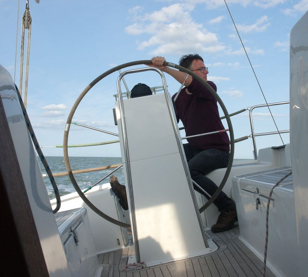 Turning the wheel and looking to windward